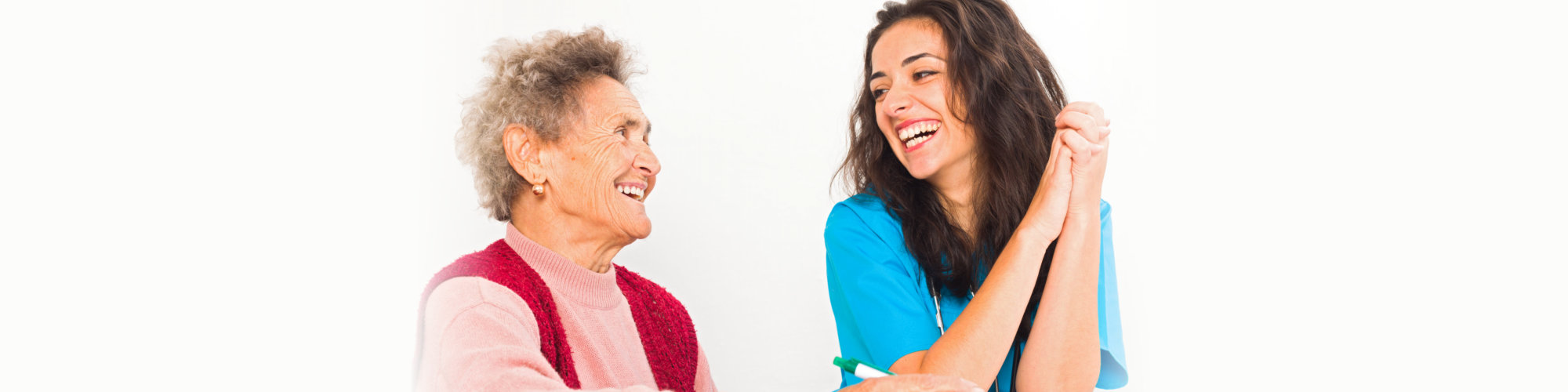 caregiver and elderly laughing