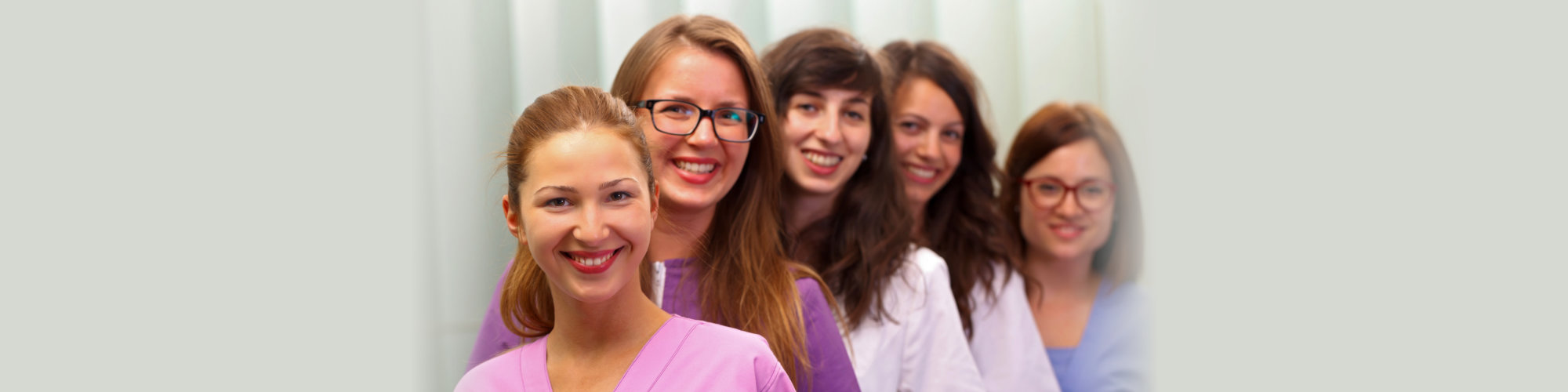 Beautiful female nurses standing in the office